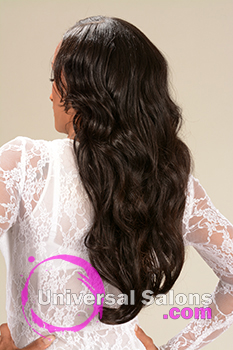 Back View of a Long Hairstyle for Black Women with Soft Curls from Marcus Doss