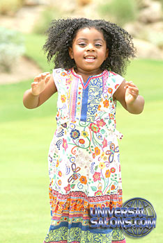 Little Girl Jumping with Tight Afro Curls