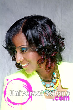 Tiffany Hudson's Divine Wine Natural Blowout Hairstyle with Highlights