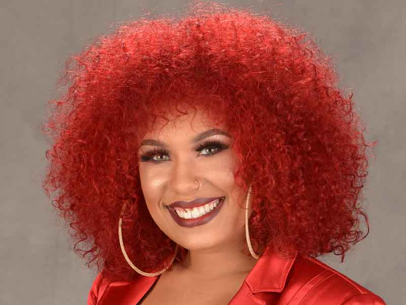 Natural Curly Hairstyle with Fire Red Hair Color