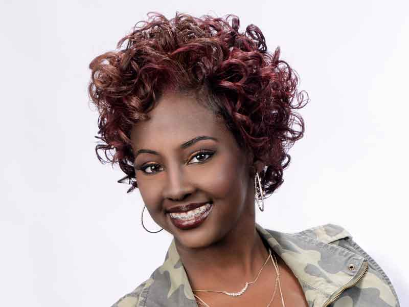 Mid-Length Curly Hairstyle with Hair Color from Patricia Clinkscales