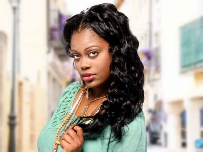 Long Wavy Sew In Black Hairstyle
