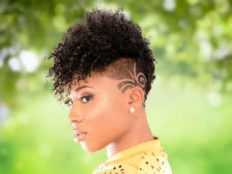 Bold Mohawk Hairstyle with Tight Bangs and Tapered Sides