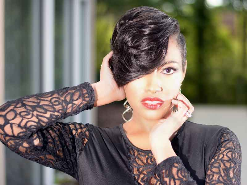 Short Hairstyle for Black Women with a Pee-a-Boo Bang
