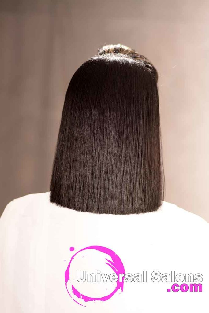 Back View: Silk Press Hairstyle with Jet Black Hair Color from Nikki Glasgow in Columbia, SC