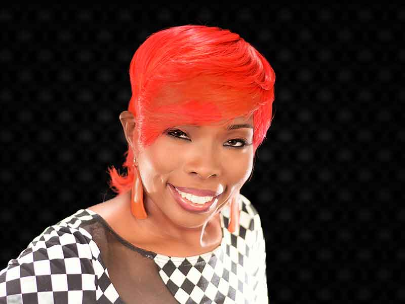 Fire Red Quick Weave Hairstyle from Yvette Alston in Columbia, SC