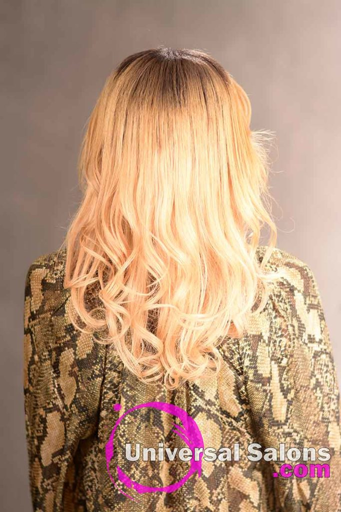 The Back View of a Long Curly Sew-In Hairstyle