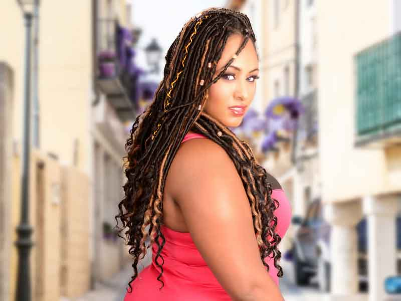 Model Wearing Long Goddess Locks Hairstyle With Accents