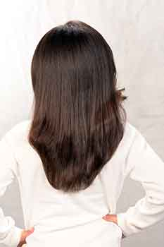 Back View: Long Silk Press Hairstyle with Side Bang
