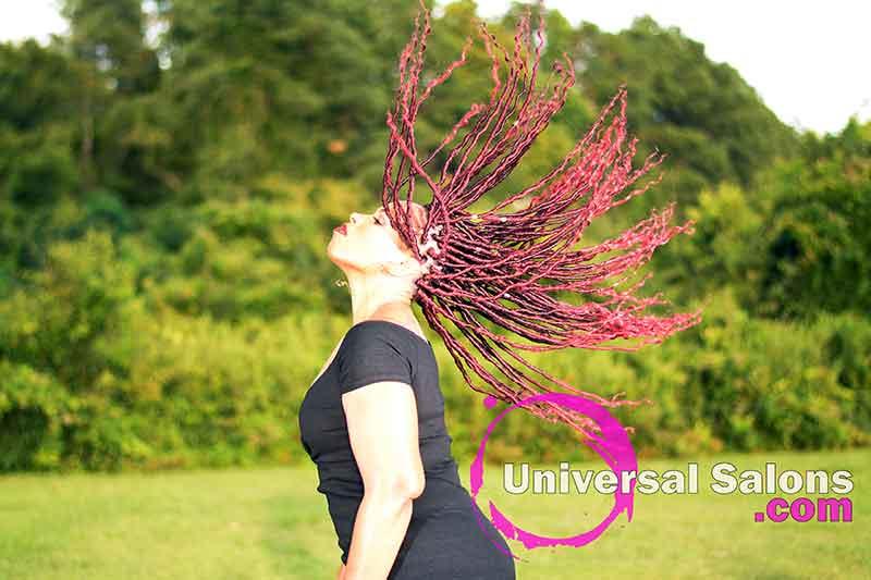 Model Flipping Her Long Goddess Locks Hairstyle