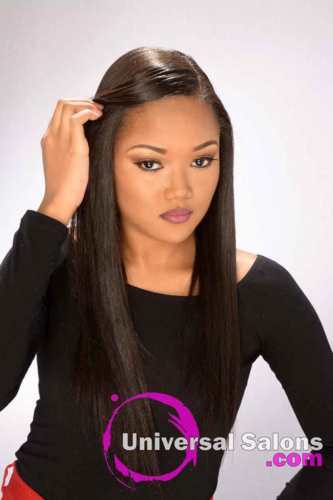 Model With Hands in Hair Long Silk Press Hairstyle
