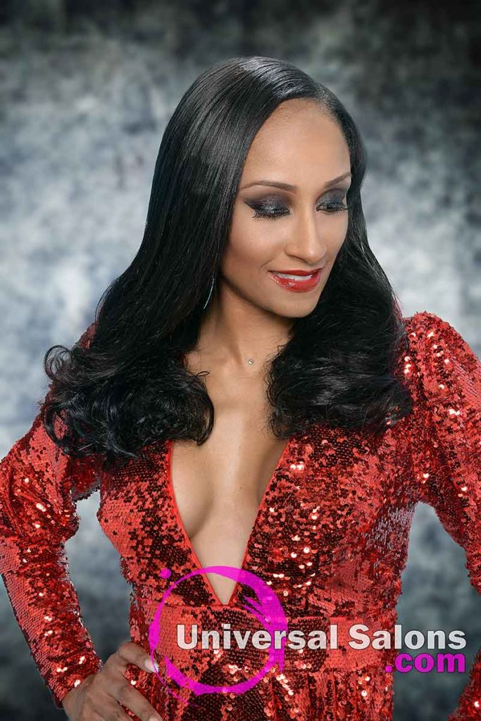Model Looking Down With Long Sew-in Weave HairstyleWith Curls