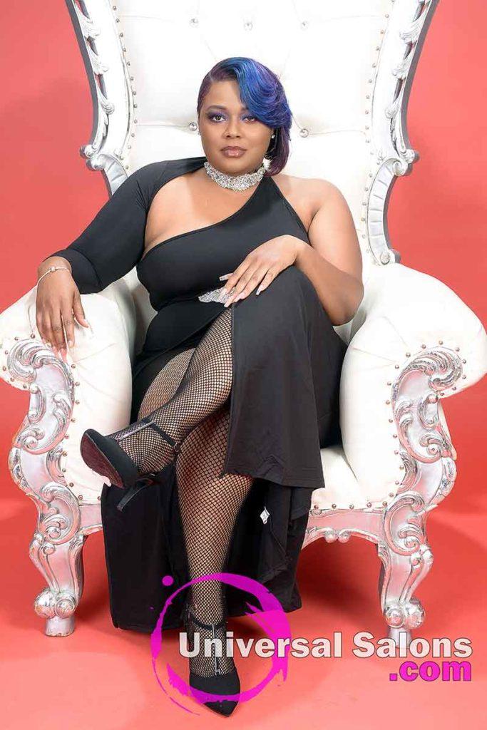 Model Sitting With Crossed Legs