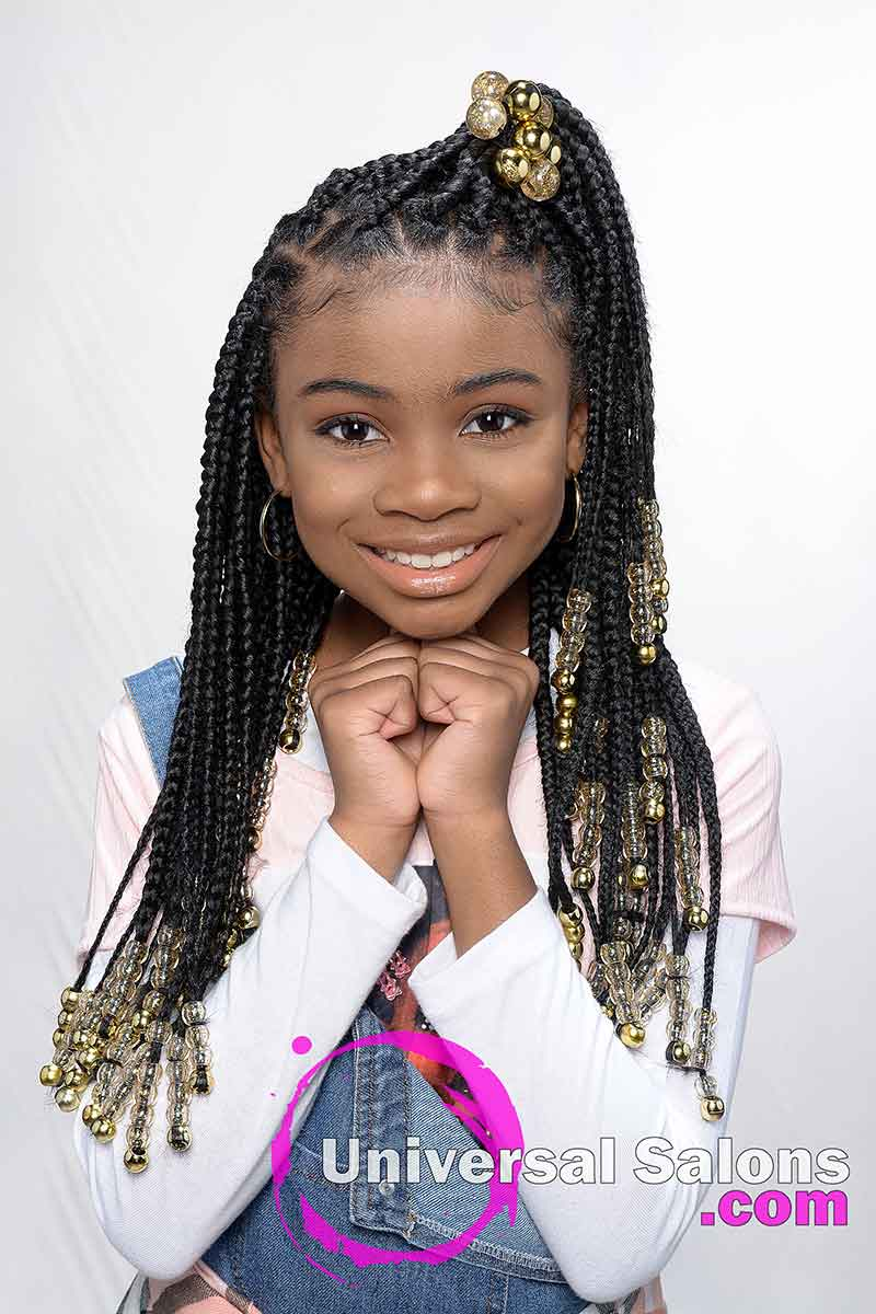 Model Smiling With Kid's Knotless Box Braids With Beads
