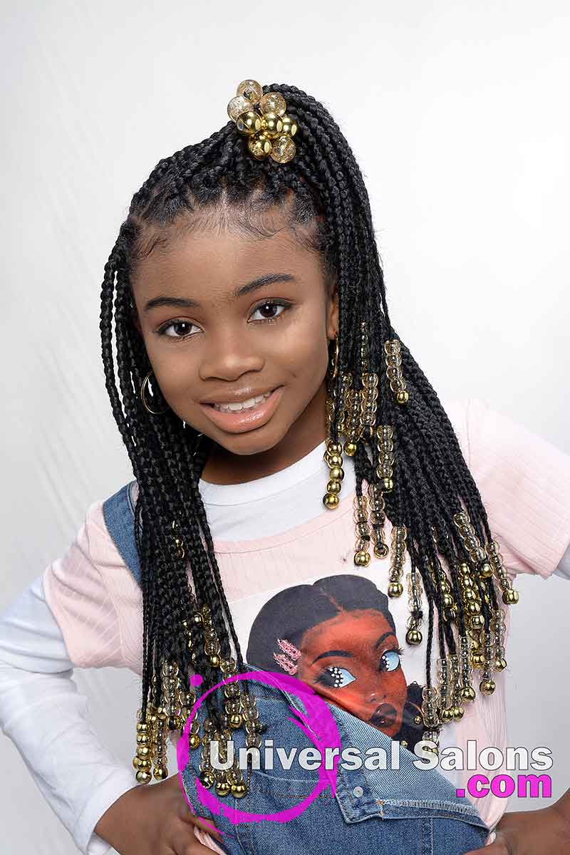 Model Smiling With Box Braids and Beads